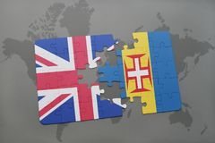 Puzzle with the national flag of great britain and madeira on a world map background Stock Images