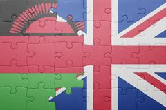 Puzzle with the national flag of great britain and malawi Stock Photography
