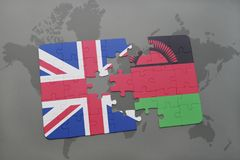 Puzzle with the national flag of great britain and malawi on a world map background. Puzzle with the national flag of great britain and malawion a world map Stock Photography
