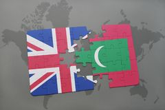 Puzzle with the national flag of great britain and maldives on a world map background. Stock Image