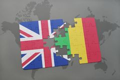 Puzzle with the national flag of great britain and mali on a world map background. Stock Photos