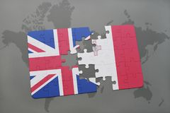 Puzzle with the national flag of great britain and malta on a world map background. Concept Royalty Free Stock Photos
