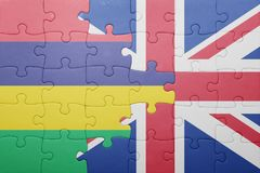 Puzzle with the national flag of great britain and mauritius Royalty Free Stock Photo