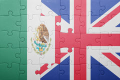 Puzzle with the national flag of great britain and mexico. Concept royalty free stock image
