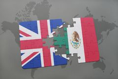 Puzzle with the national flag of great britain and mexico on a world map background. Royalty Free Stock Photo