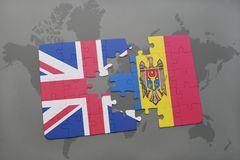 Puzzle with the national flag of great britain and moldova on a world map background Stock Photo
