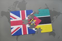 Puzzle with the national flag of great britain and mozambique on a world map background. 3D illustration Royalty Free Stock Photography