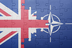 Puzzle with the national flag of great britain and nato Stock Images