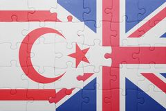 Puzzle with the national flag of great britain and northern cyprus Stock Image