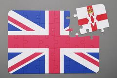 Puzzle with national flag of great britain and northern ireland piece detached. Royalty Free Stock Photo