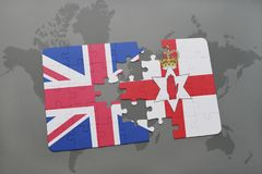 Puzzle with the national flag of great britain and northern ireland on a world map background Royalty Free Stock Image