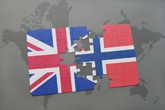 Puzzle with the national flag of great britain and norway on a world map background. Concept Stock Photos