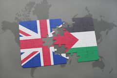 Puzzle with the national flag of great britain and palestine on a world map background. Royalty Free Stock Photos