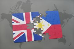 Puzzle with the national flag of great britain and philippines on a world map background. Stock Photos