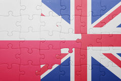 Puzzle with the national flag of great britain and poland. Concept Stock Photography