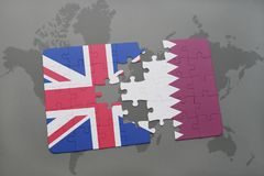 Puzzle with the national flag of great britain and qatar on a world map background. Stock Photo