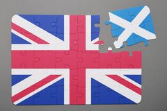 Puzzle with national flag of great britain and scotland piece detached. Concept Stock Image