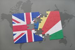 Puzzle with the national flag of great britain and seychelles on a world map background. 3D illustration Royalty Free Stock Photography