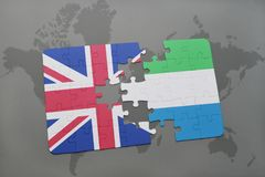 Puzzle with the national flag of great britain and sierra leone on a world map background. Stock Photos