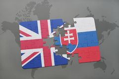 Puzzle with the national flag of great britain and slovakia on a world map background. Concept Stock Photos