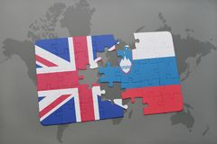 Puzzle with the national flag of great britain and slovenia on a world map background. Concept Royalty Free Stock Images