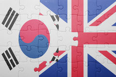 Puzzle with the national flag of great britain and south korea. Concept royalty free stock photos