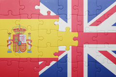 Puzzle with the national flag of great britain and spain Stock Images