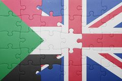 Puzzle with the national flag of great britain and sudan Royalty Free Stock Photo