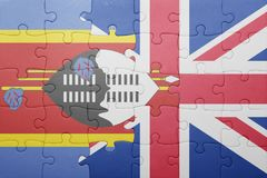 Puzzle with the national flag of great britain and swaziland Stock Images