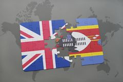 Puzzle with the national flag of great britain and swaziland on a world map background. Royalty Free Stock Image