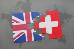 Puzzle with the national flag of great britain and switzerland on a world map background Stock Photos