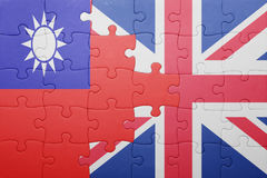Puzzle with the national flag of great britain and taiwan. Concept Stock Photo
