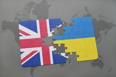Puzzle with the national flag of great britain and ukraine on a world map background Royalty Free Stock Photography