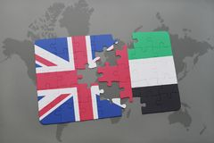 Puzzle with the national flag of great britain and united arab emirates on a world map background. Royalty Free Stock Photography
