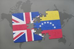 Puzzle with the national flag of great britain and venezuela on a world map background. Royalty Free Stock Photography