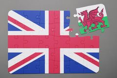 Puzzle with national flag of great britain and wales piece detached. Concept Royalty Free Stock Photography