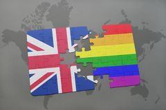 Puzzle with the national flag of great britain and gay rainbow flag on a world map background Stock Photos