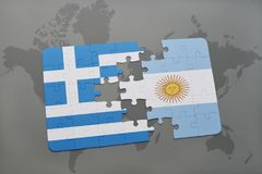 Puzzle with the national flag of greece and argentina on a world map background. Royalty Free Stock Photo