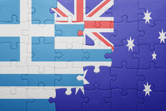 Puzzle with the national flag of greece and australia Stock Photo