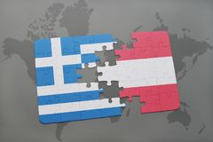 Puzzle with the national flag of greece and austria on a world map background. 3D illustration Royalty Free Stock Image