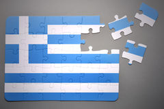 Puzzle with the national flag of greece Royalty Free Stock Photo
