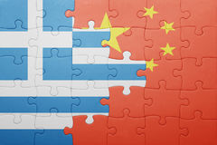 Puzzle with the national flag of greece and china Stock Photos