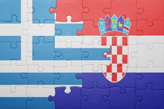 Puzzle with the national flag of greece and croatia Royalty Free Stock Images
