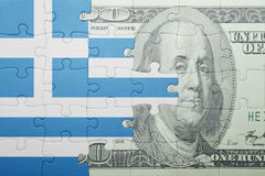 Puzzle with the national flag of greece and dollar banknote Stock Photography