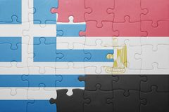 Puzzle with the national flag of greece and egypt. Concept Stock Image