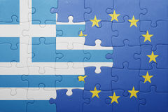 Puzzle with the national flag of greece and european union Stock Photos