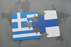 Puzzle with the national flag of greece and finland on a world map background. Stock Images