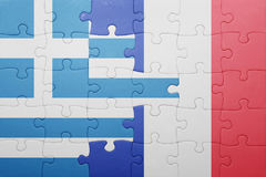 Puzzle with the national flag of greece and france Stock Images