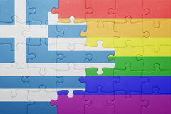 Puzzle with the national flag of greece and gay flag Stock Photos