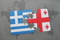 Puzzle with the national flag of greece and georgia on a world map background. Royalty Free Stock Photos